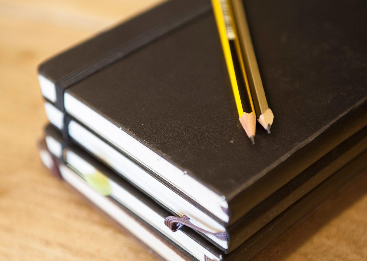 closeup-notebooks-and-pencils