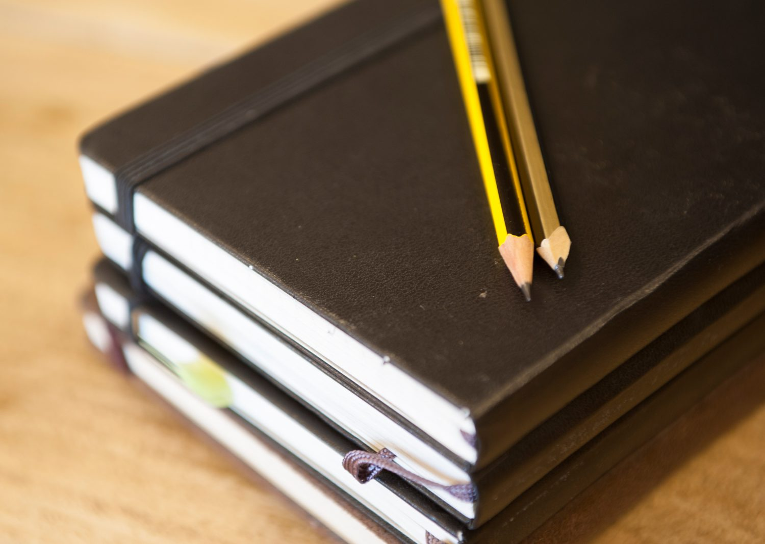 closeup-notebooks-and-pencils
