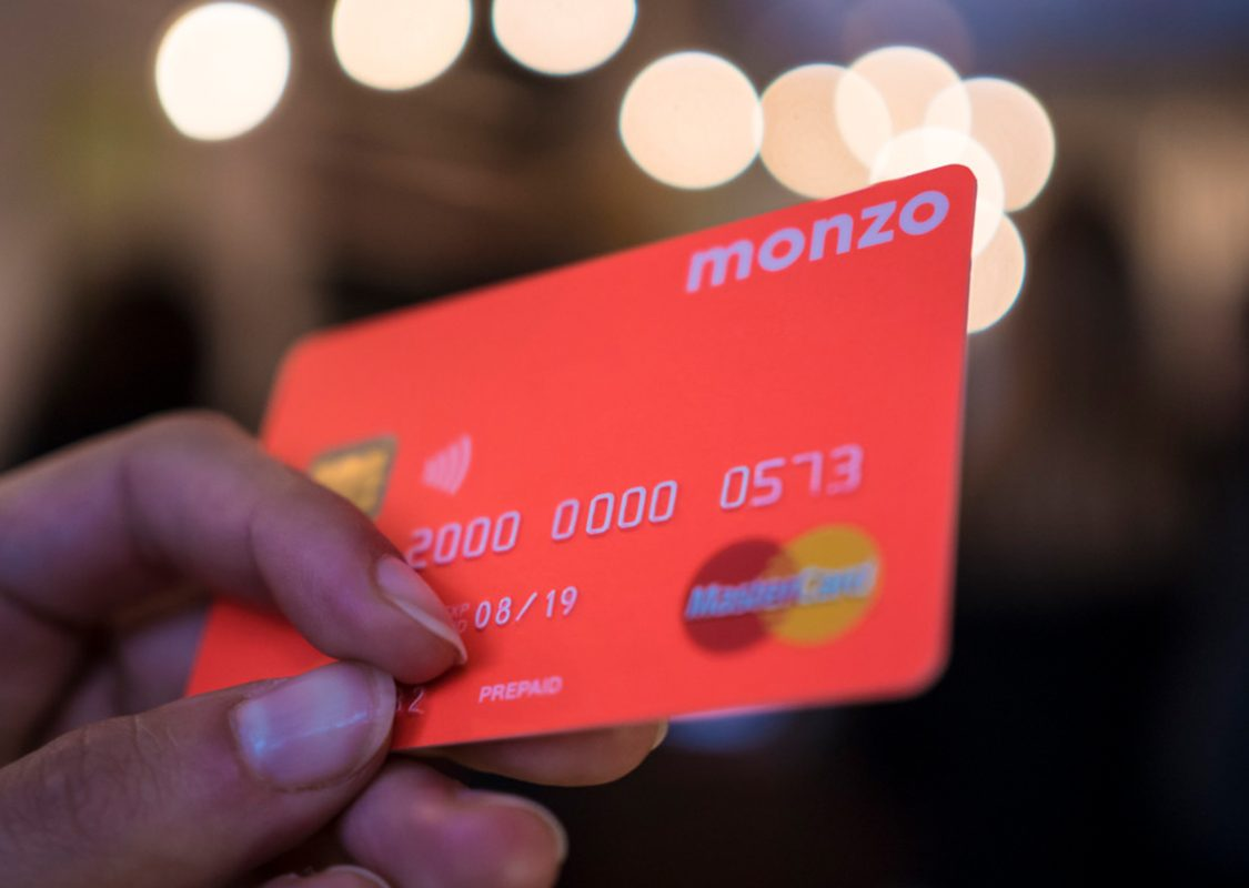 fluorescent orange Monzo credit card