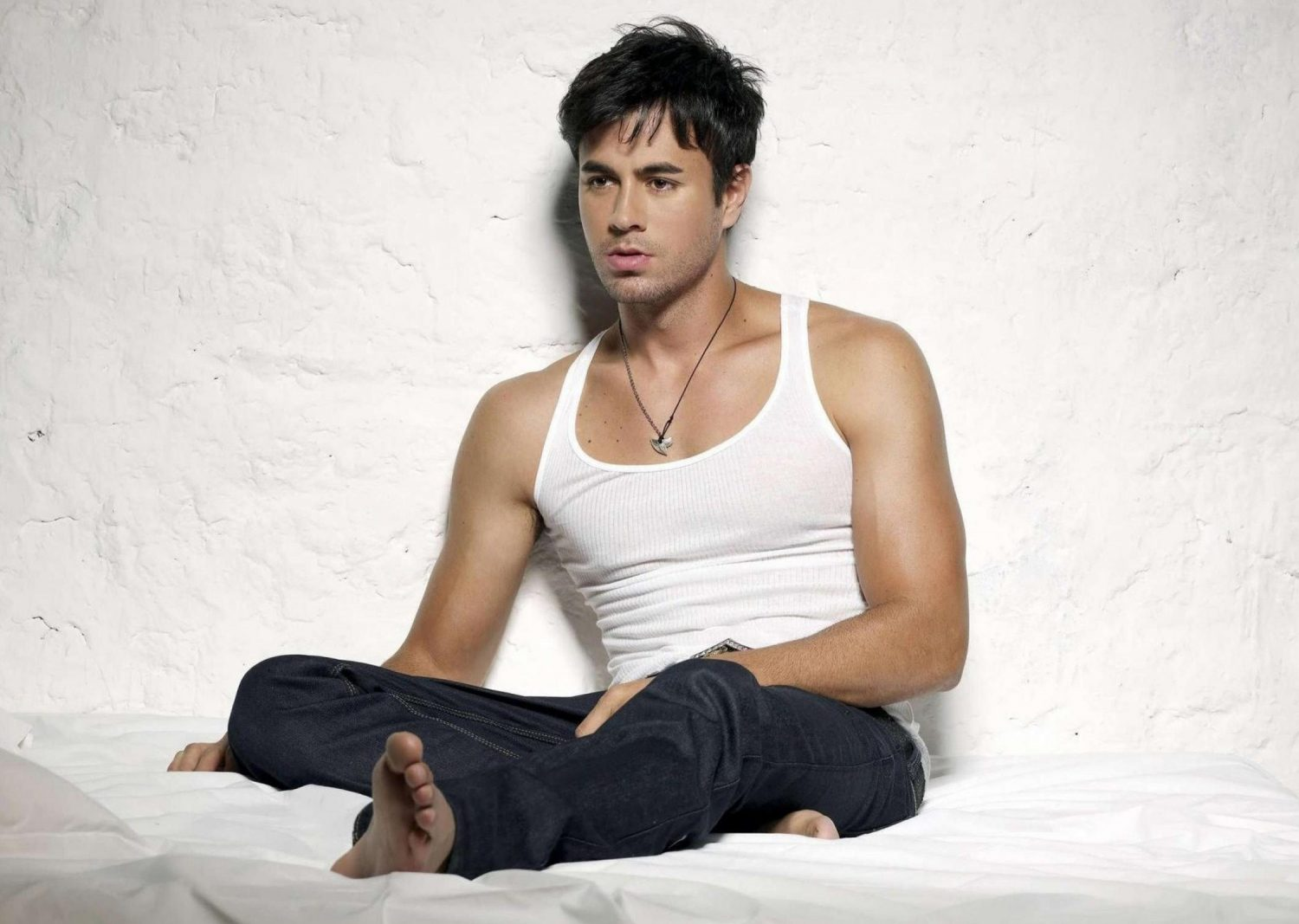Enrique Iglesias in a tank top and white background