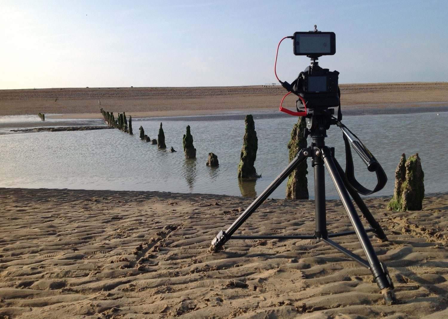 Camera on a Tripod with a beach view