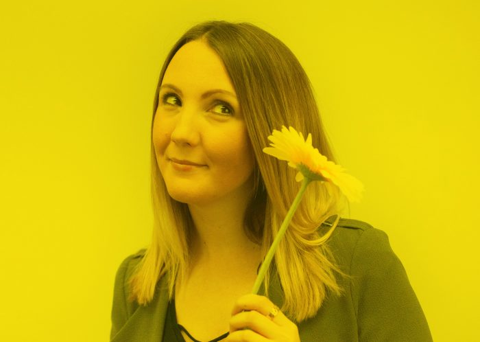 Sarah From The Hideout Holding A Flower
